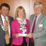 Presentation of Cheque to President Jim and Treasurer Helen by PP John
