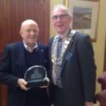 John McIlroy receives award from President David